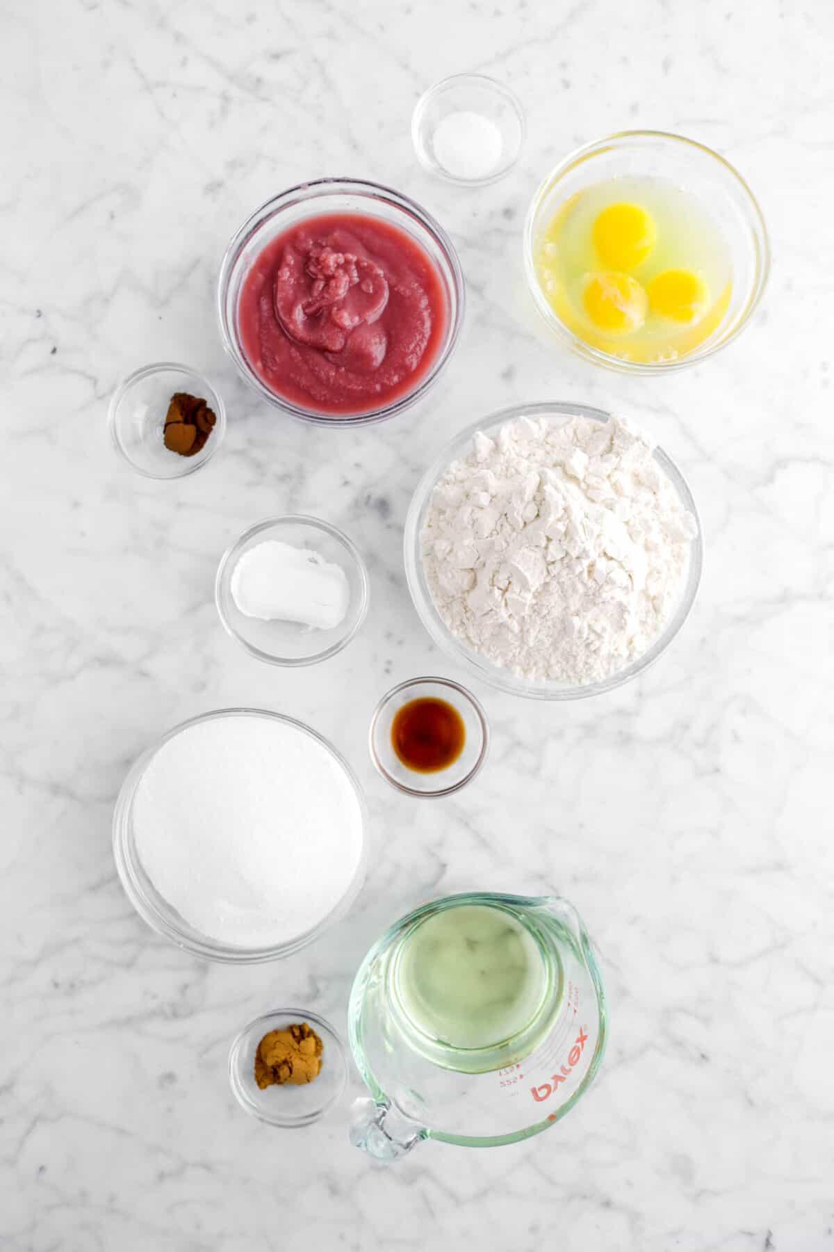 salt, baby food, cloves, eggs, flour, baking powder, vanilla, sugar, vegetable oil, and cinnamon in glass bowls