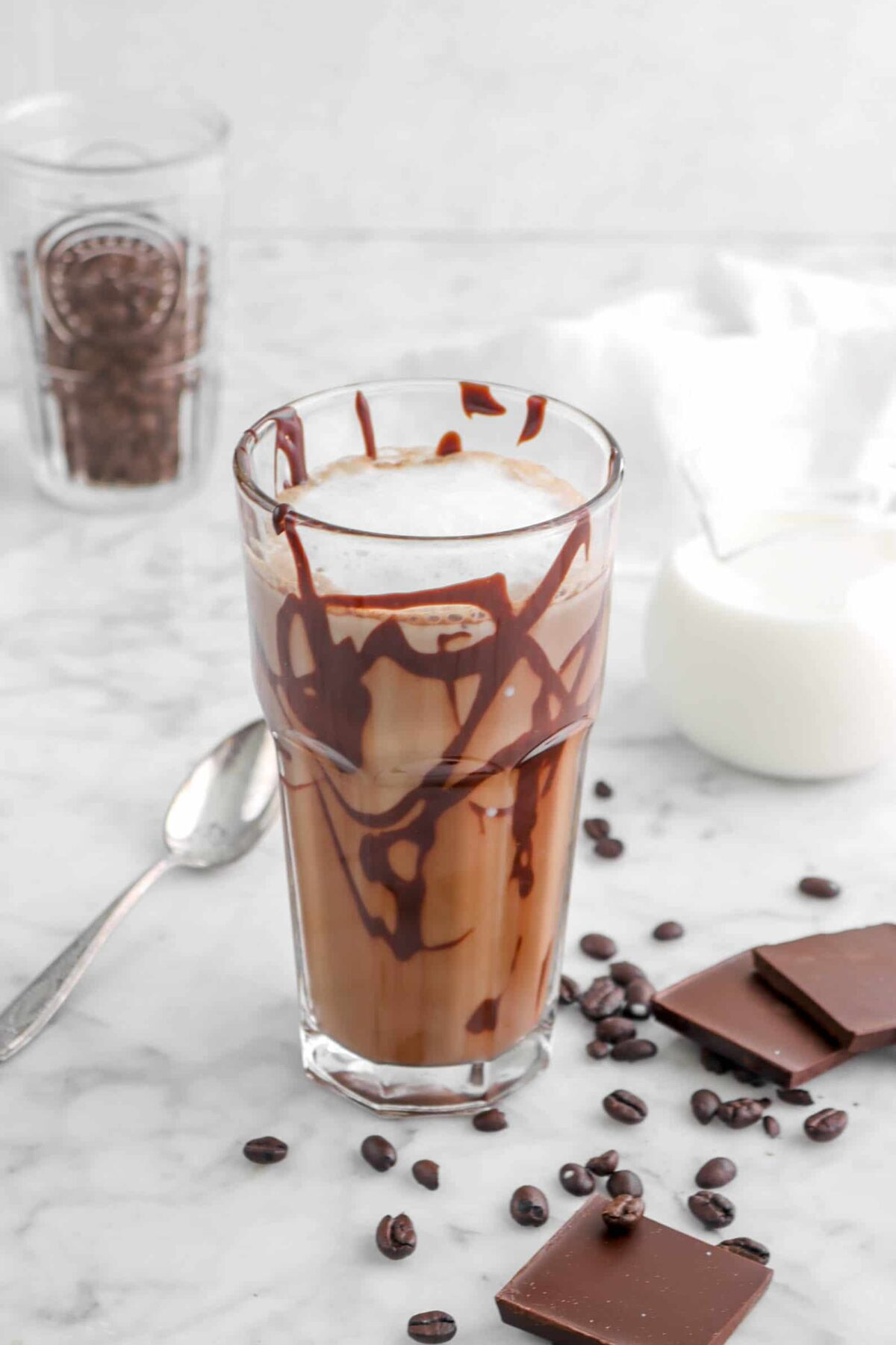 milk added to coffee in glass
