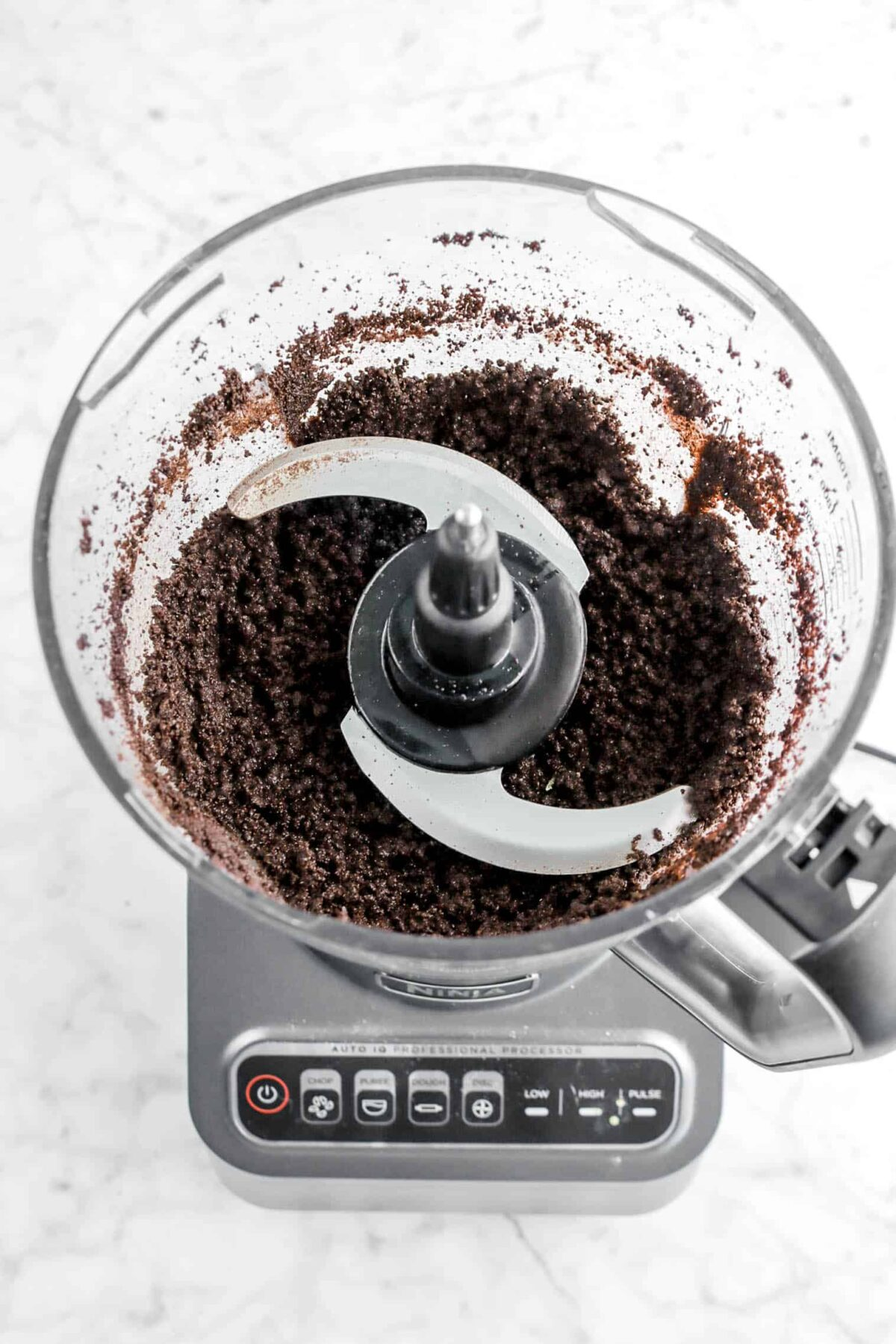 crushed oreos and butter in food processor
