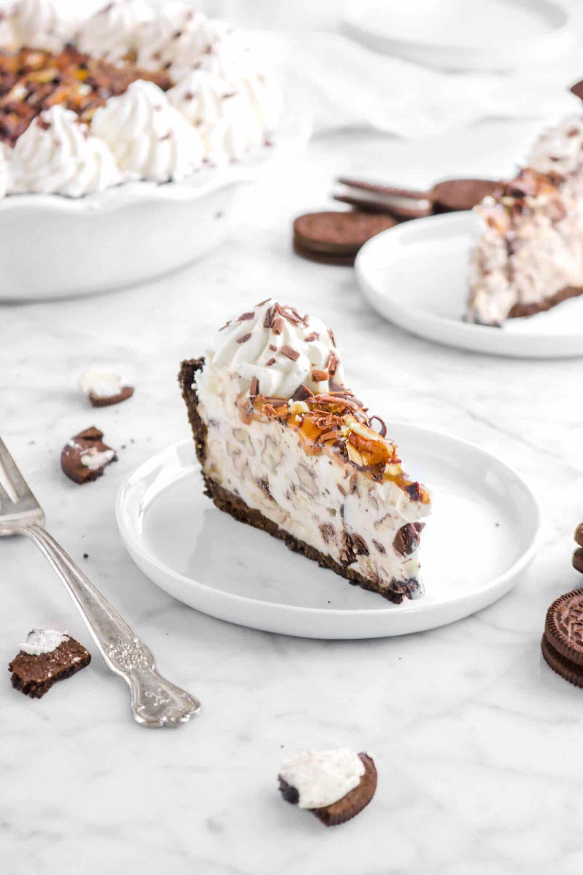 slice of turtle ice cream pie on white plate