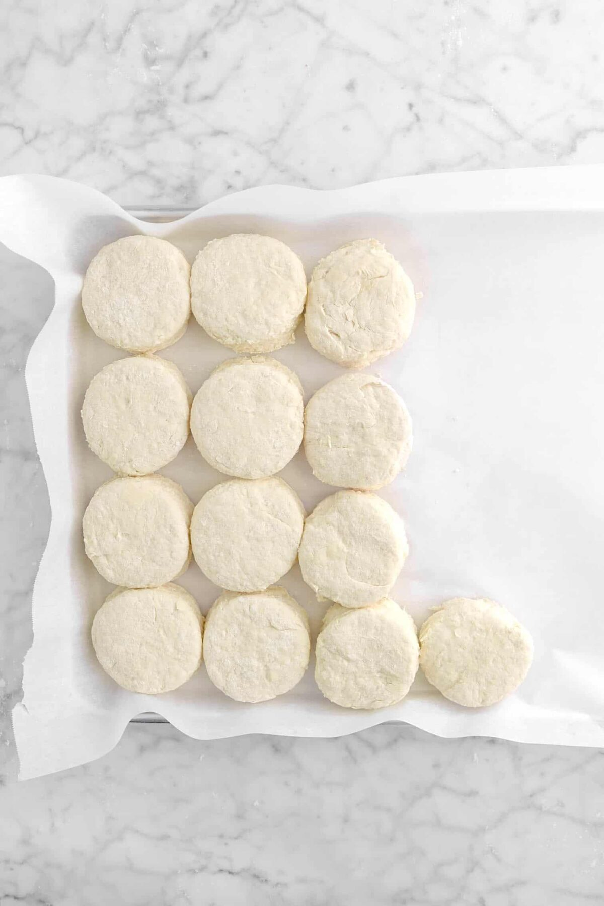 biscuits in a lined sheet pan
