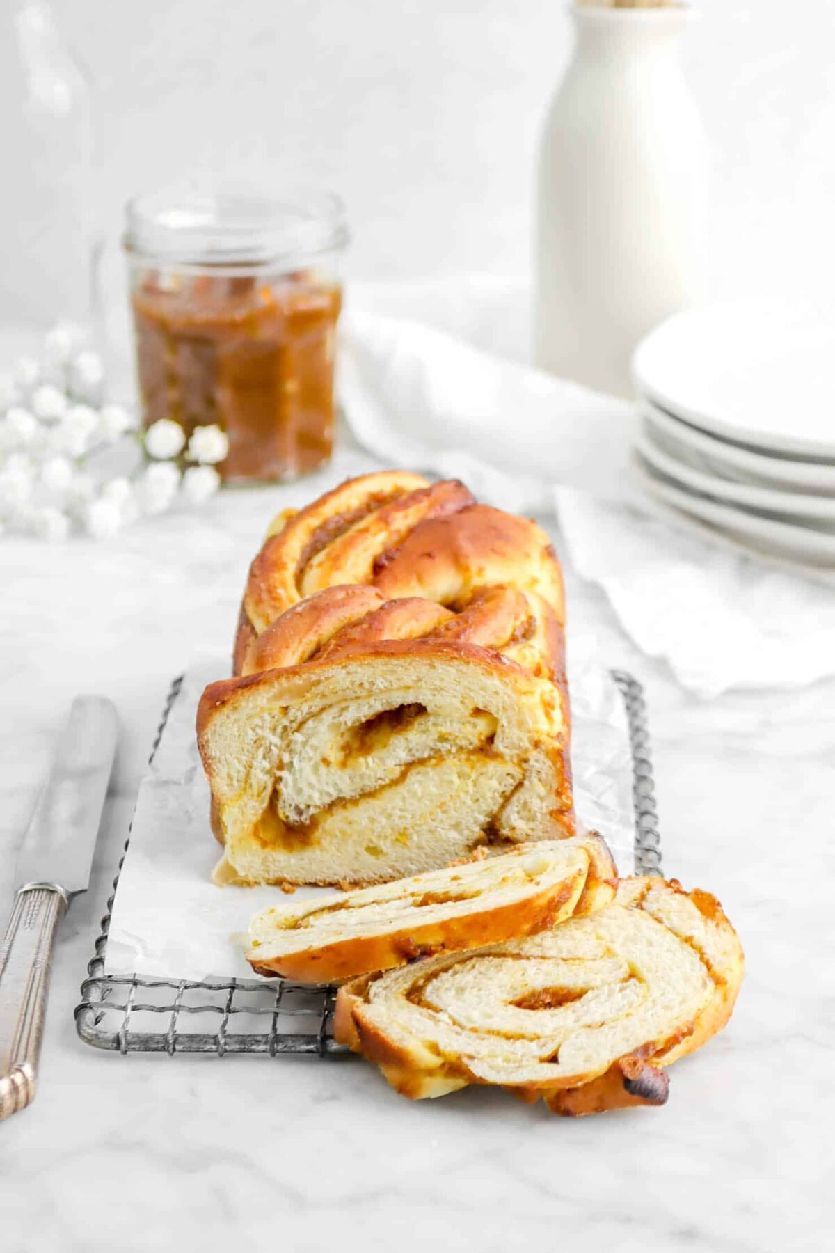 pumpkin butter babka on small serving tray with two slices laying in front