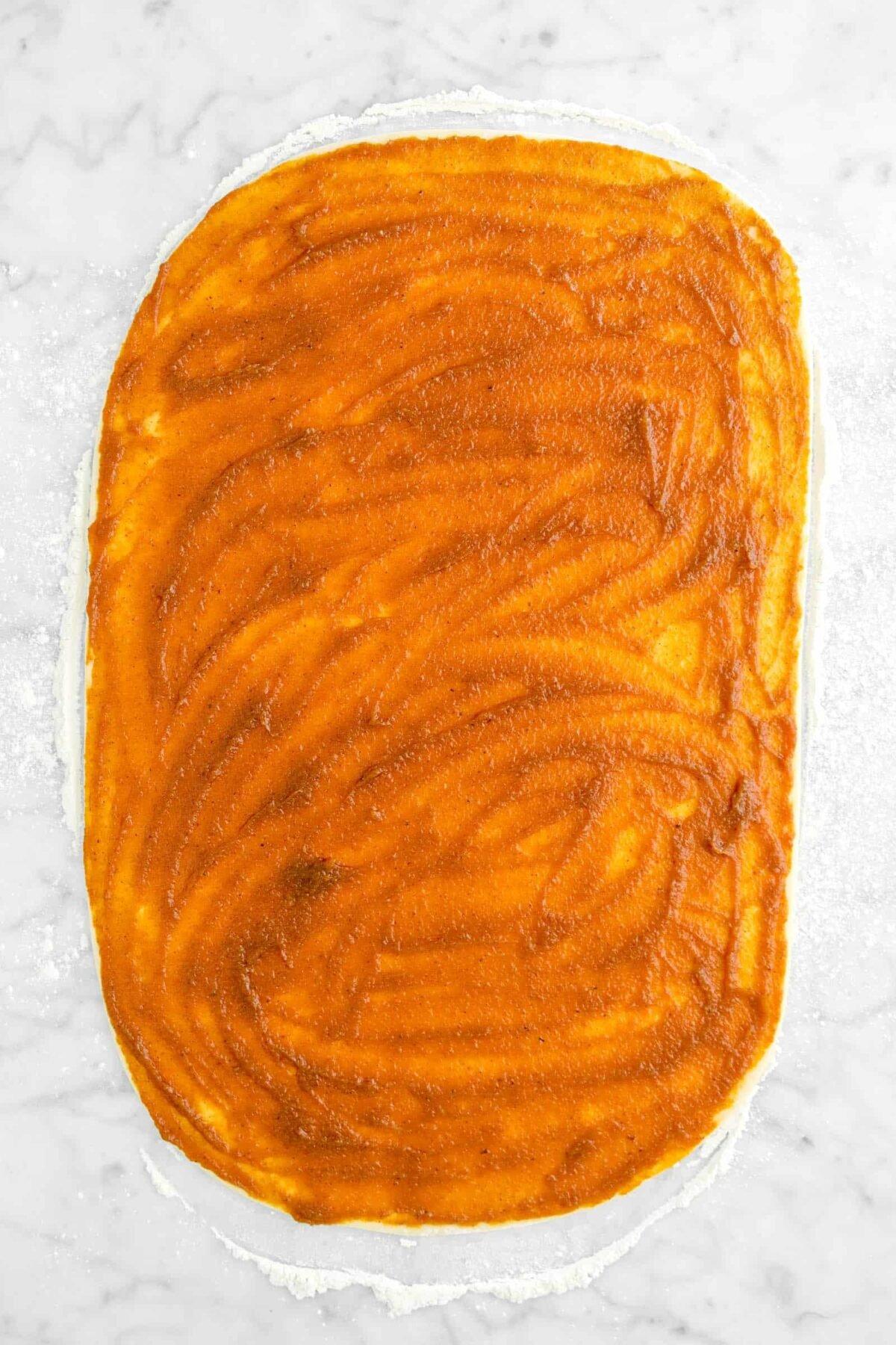 pumpkin butter spread across dough