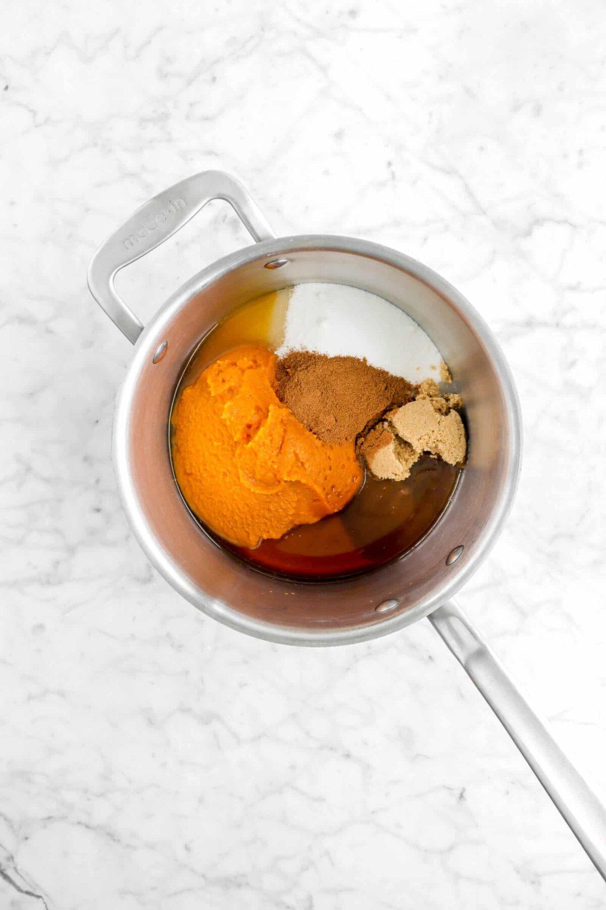 pumpkin, apple cider, sugar, brown sugar, and vanilla in a pot
