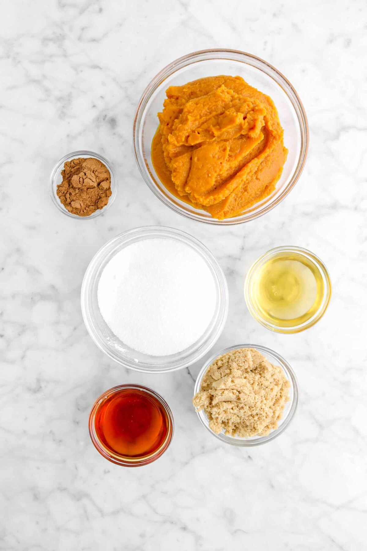 pumpkin, spice, apple cider, sugar, brown sugar, and boiled cider in glass bowls