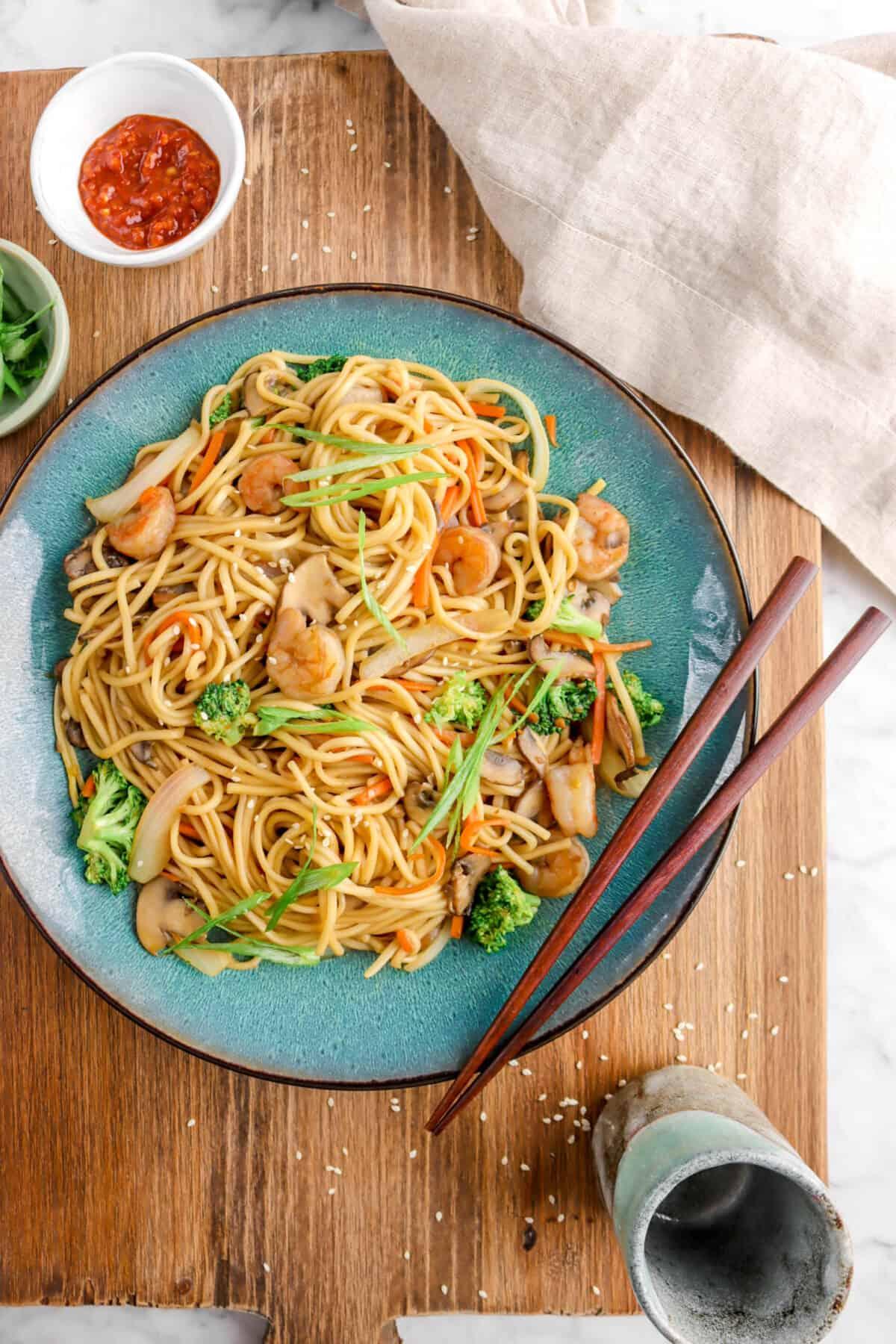 shrimp lo mein on wood board