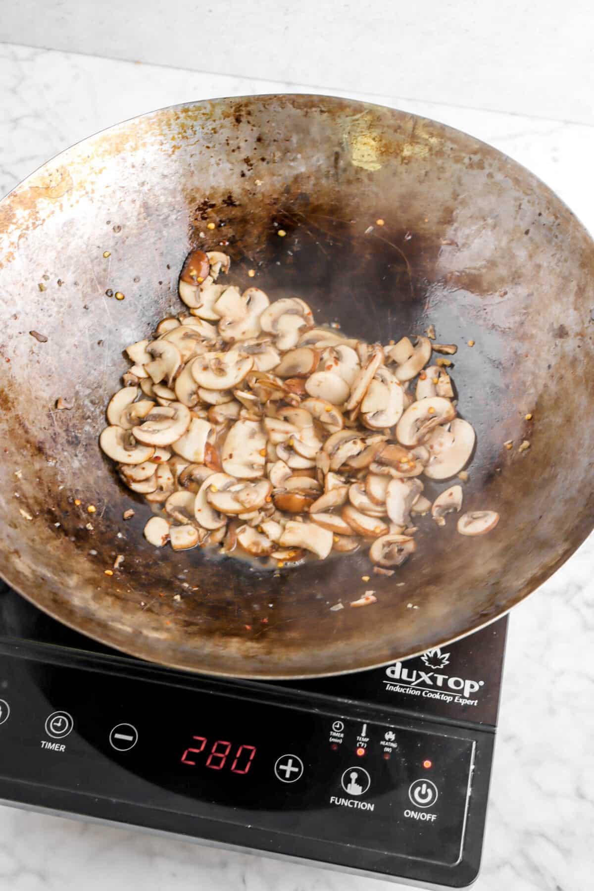 Sautéed mushrooms in a wok
