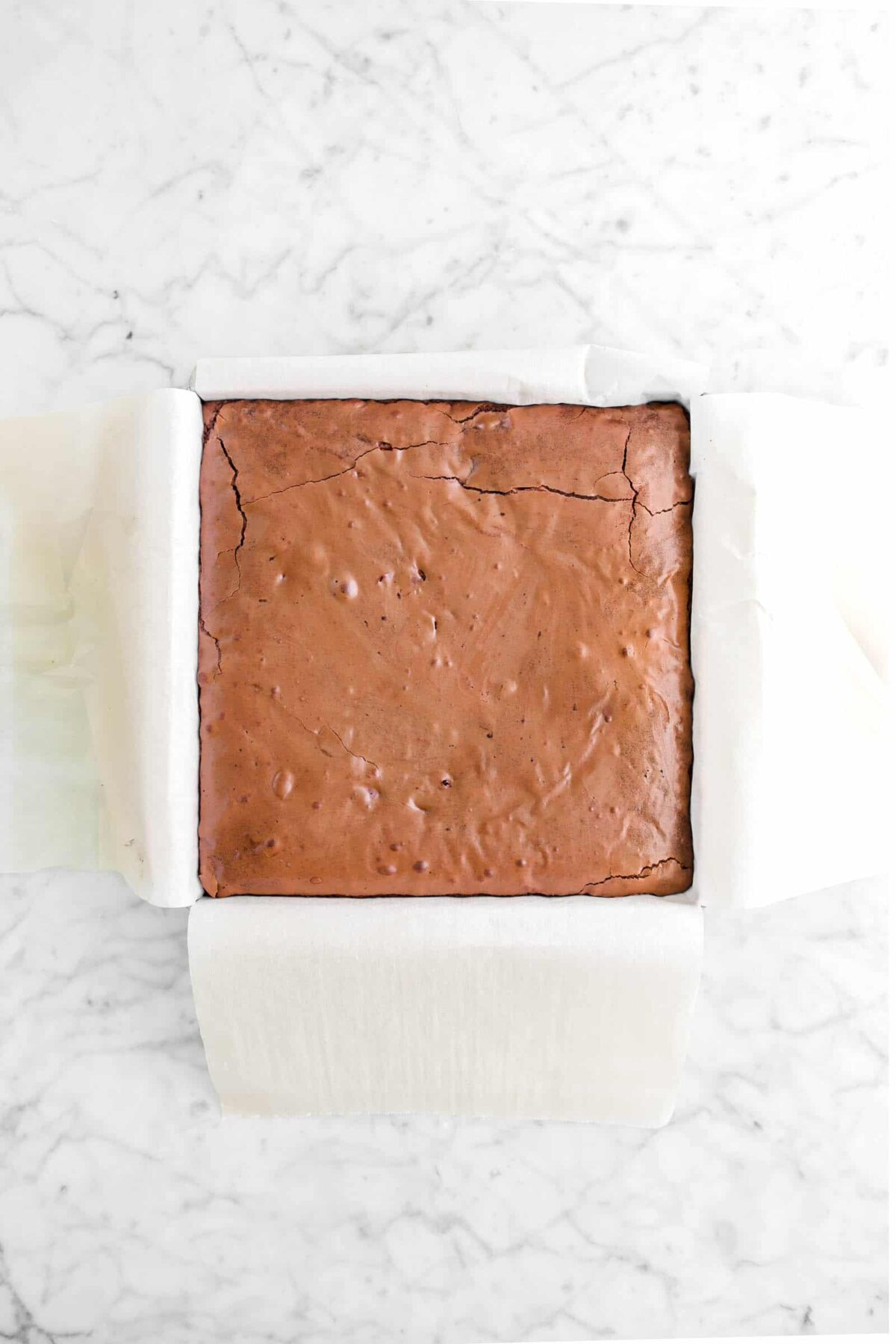 baked brownies in lined rectangular pan