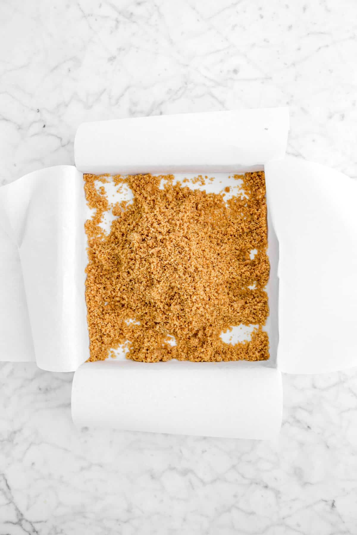 graham cracker crumbs in lined square pan