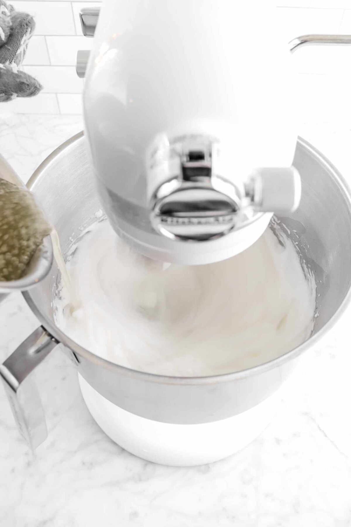 sugar syrup being poured into egg whites