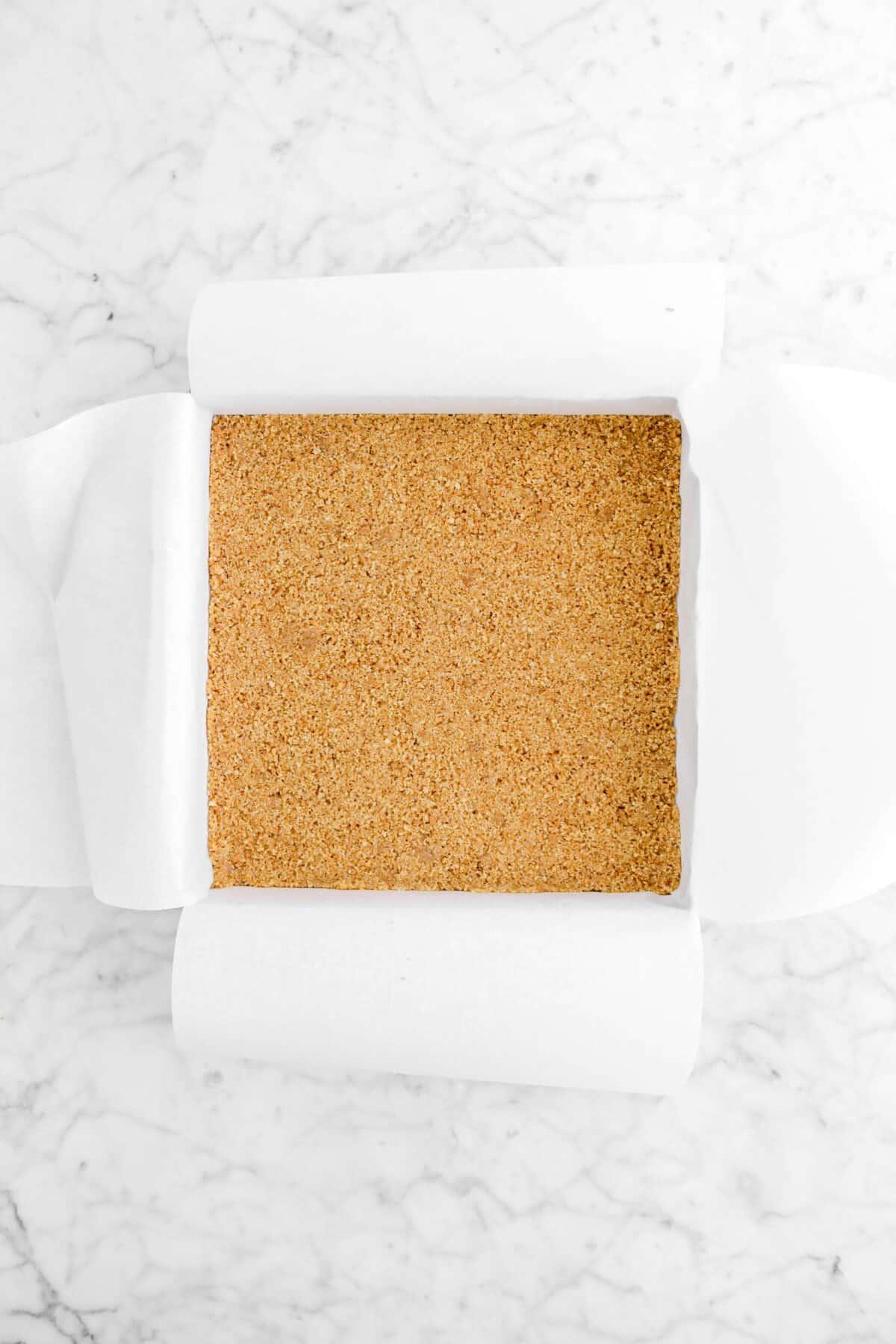 graham cracker crust in square baking pan