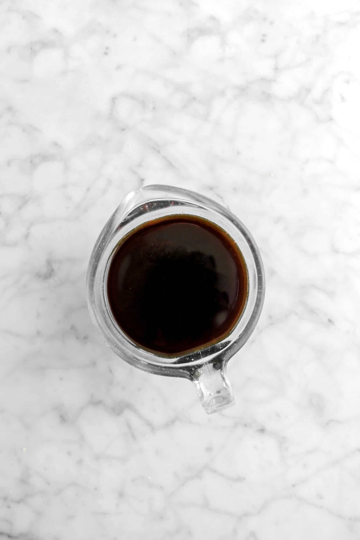 coffee liqueur and coffee mixed in measuring cup