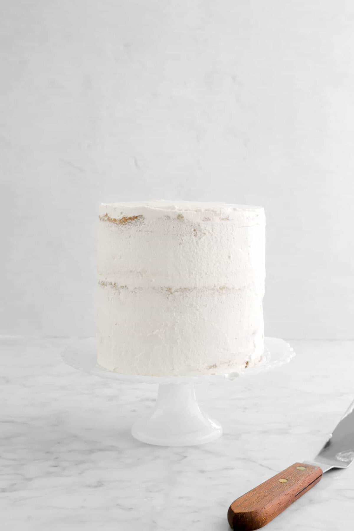 layer cake coated in chantilly cream