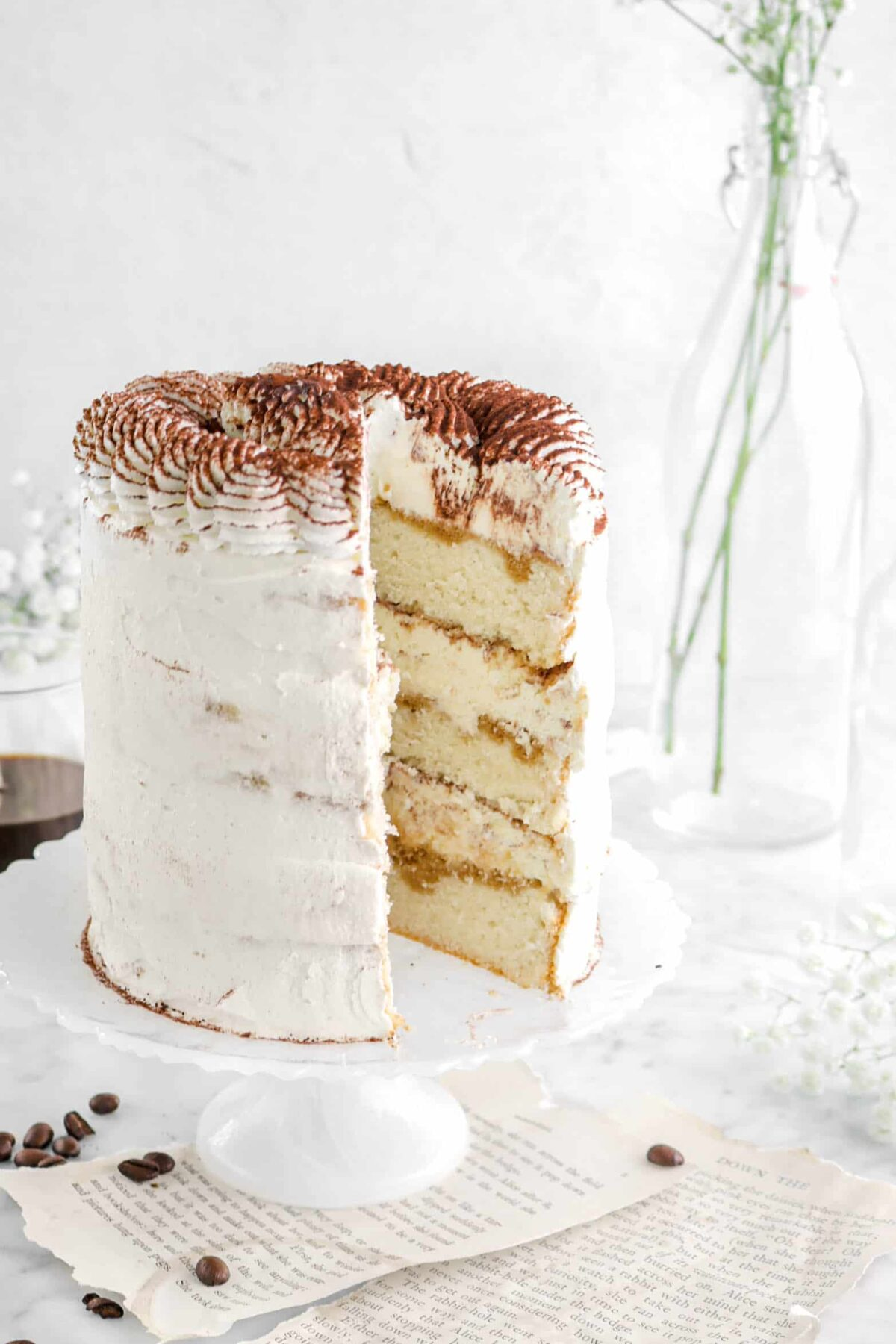 close up of tiramisu cake with slice missing