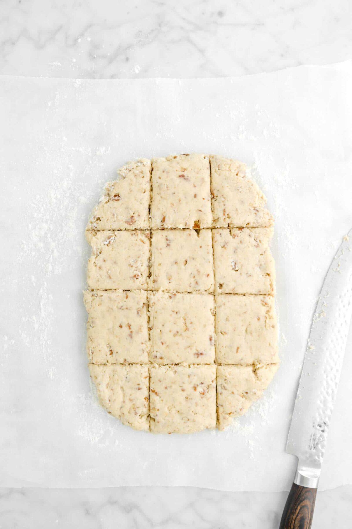 dough cut into twelve squares