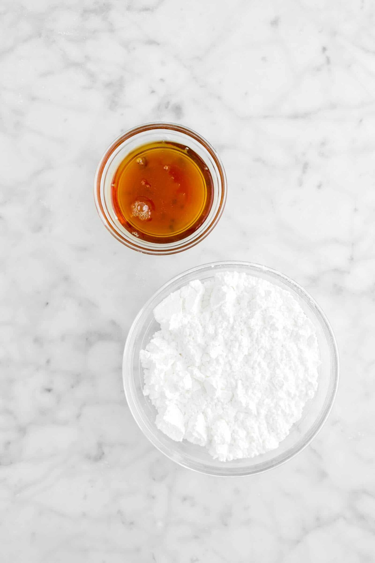 maple syrup and powdered sugar in glass bowls