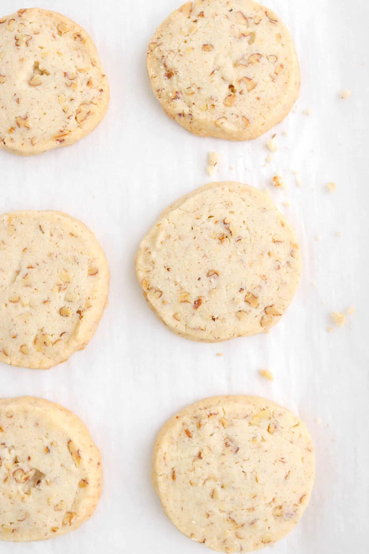 overhead shot of six cookies baked on parchment paper