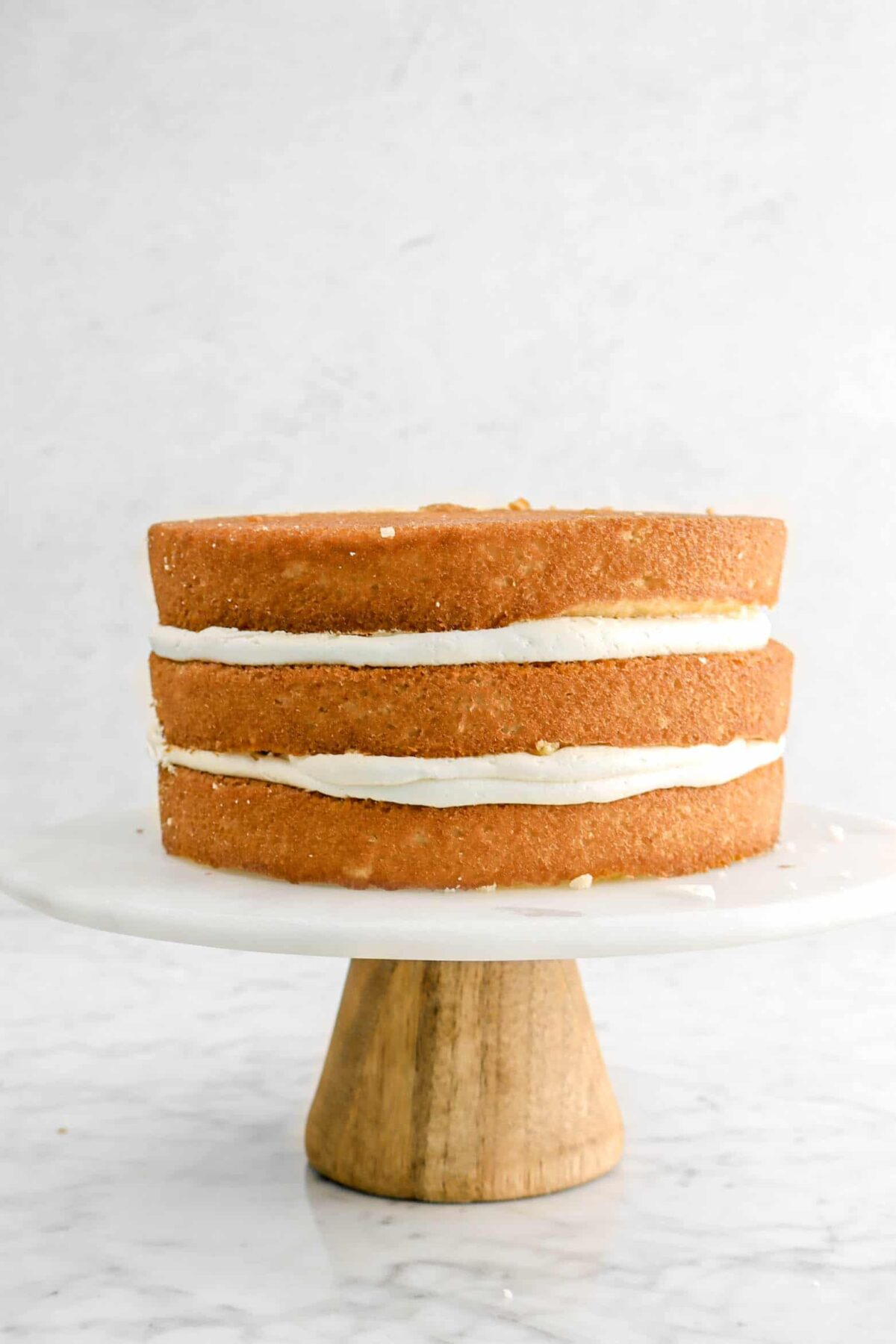 three layers of cake on cake plate