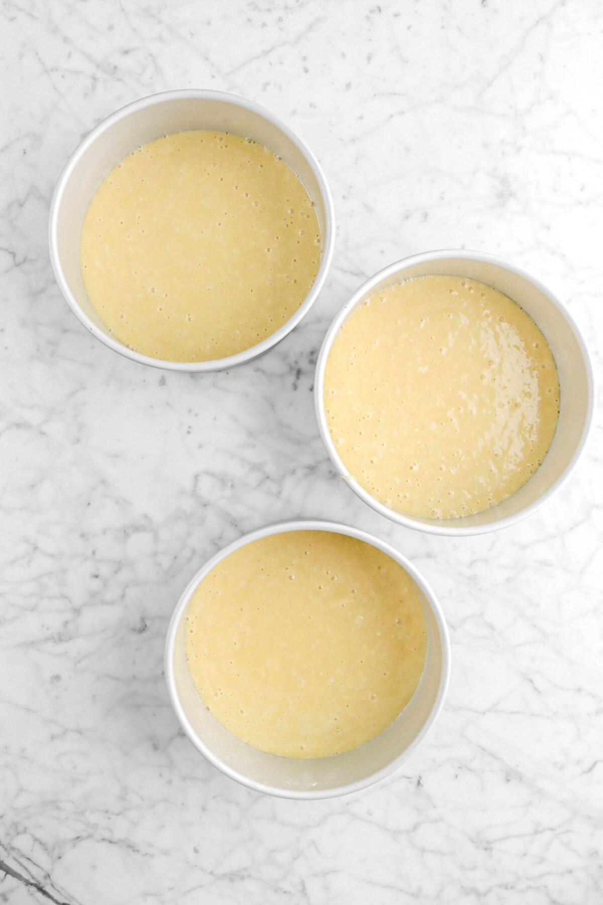 cake batter in three circle cake pans