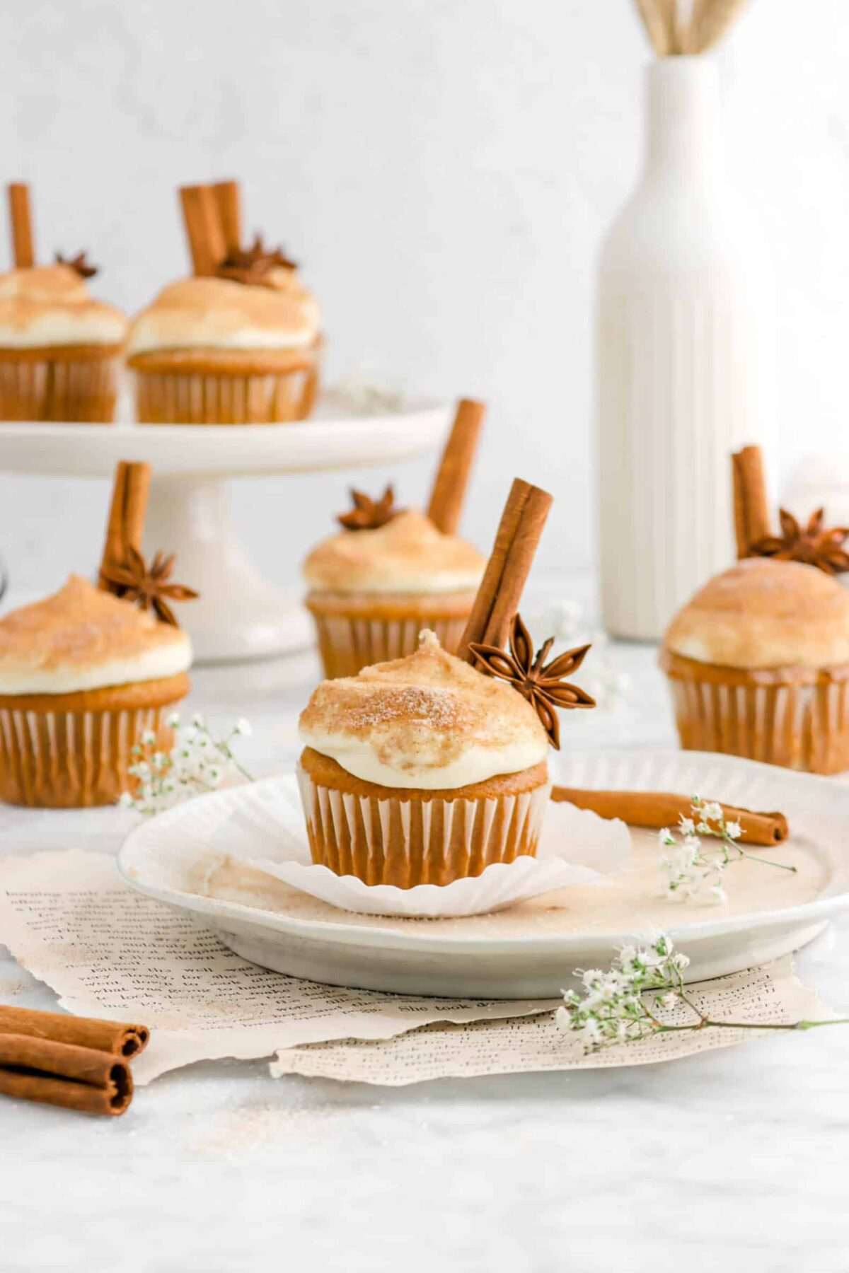 pumpkin cupcakes with spices and flowers