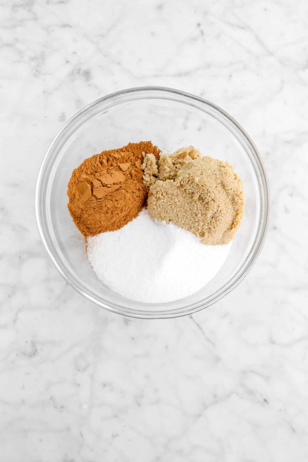 cinnamon, brown sugar, and white sugar in a glass bowl