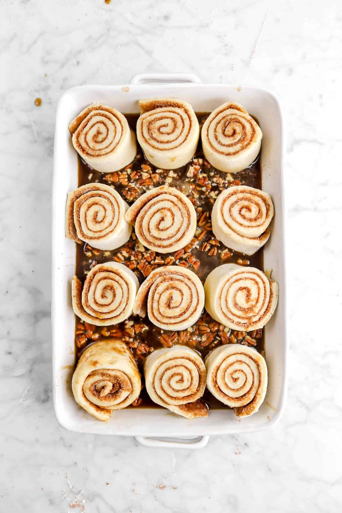 rolls in syrup in white casserole