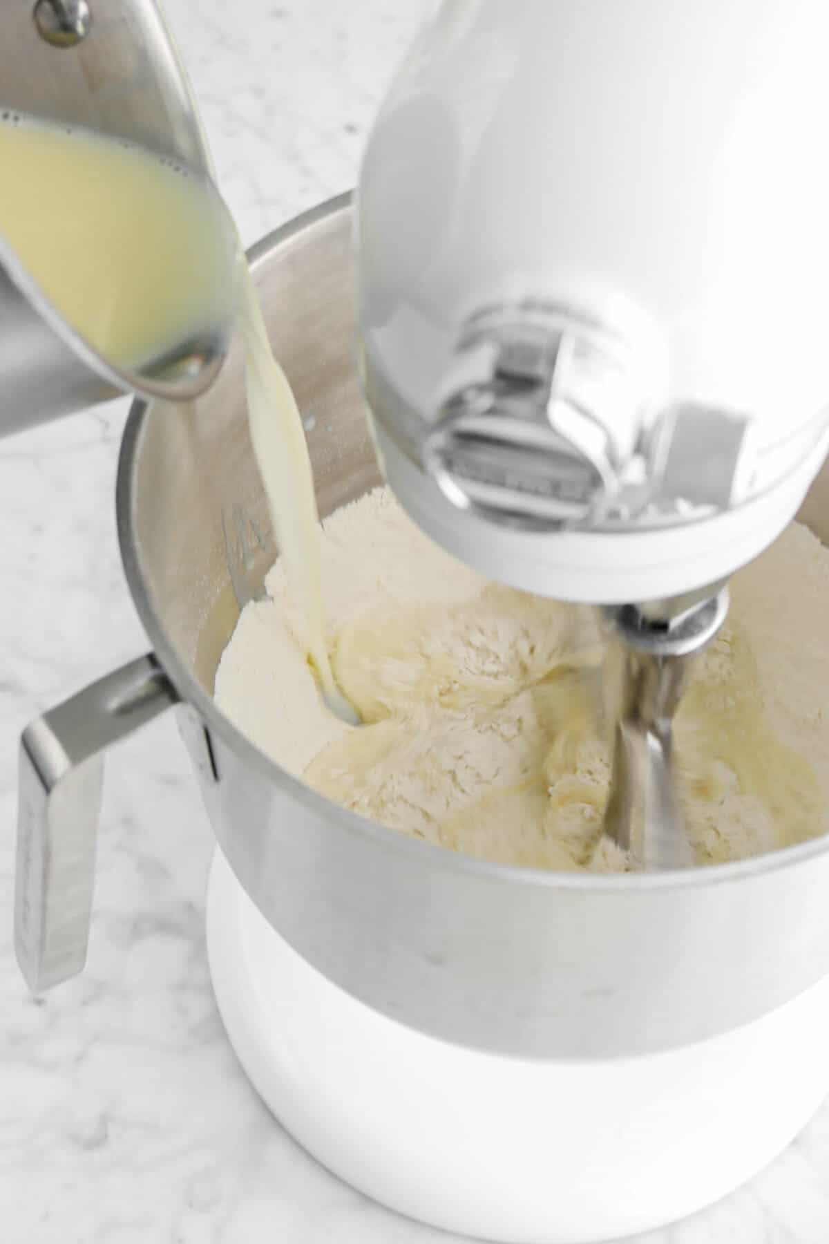 butter mixture being poured into dry ingredients