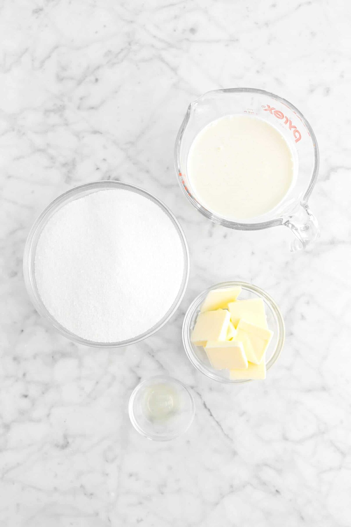cream, sugar, butter, and lemon juice on marble counter