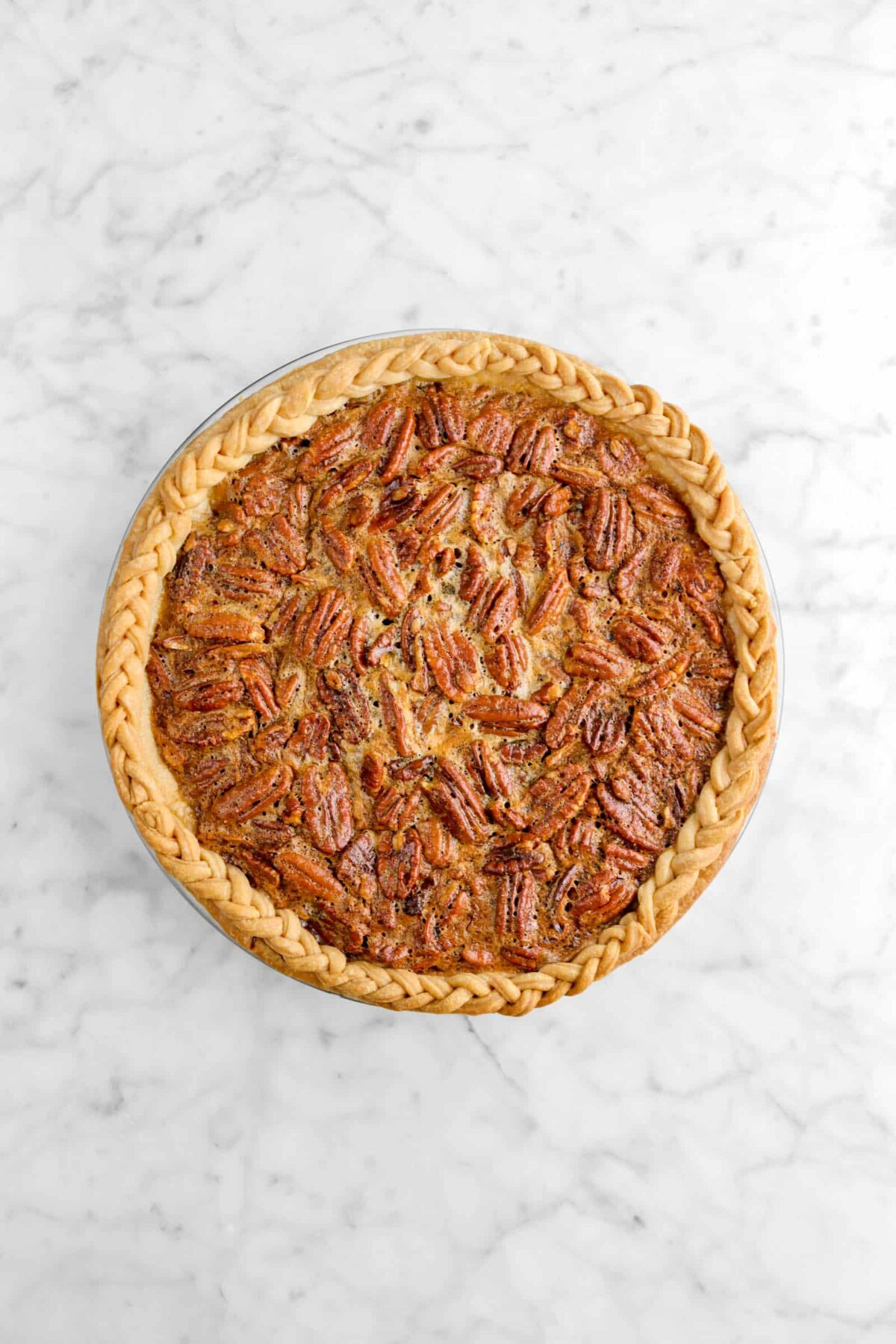 baked pecan pie on marble counter
