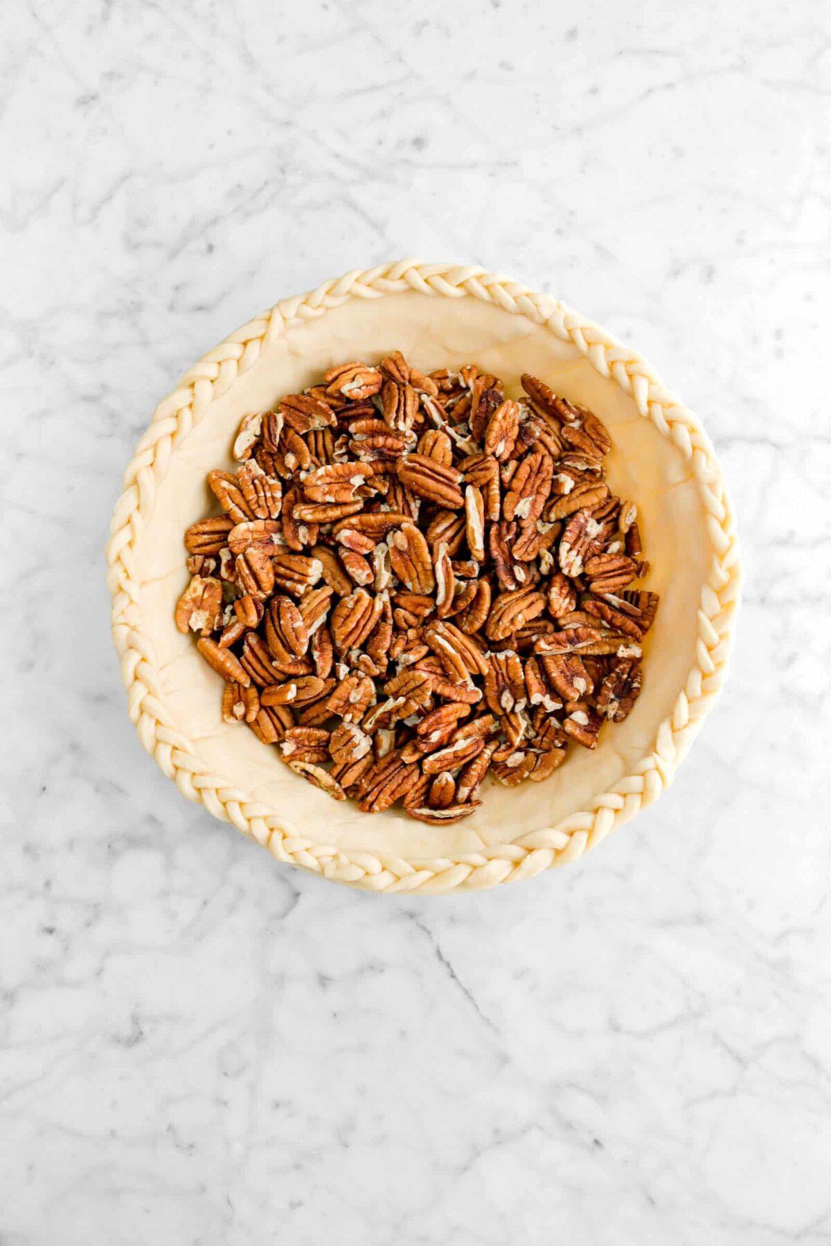 pecans in a unbaked pie crust