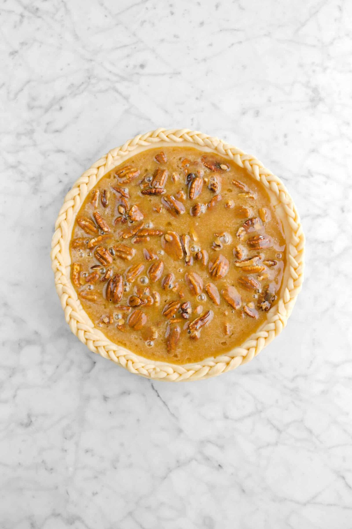 pie filling and pecans in unbaked pie crust