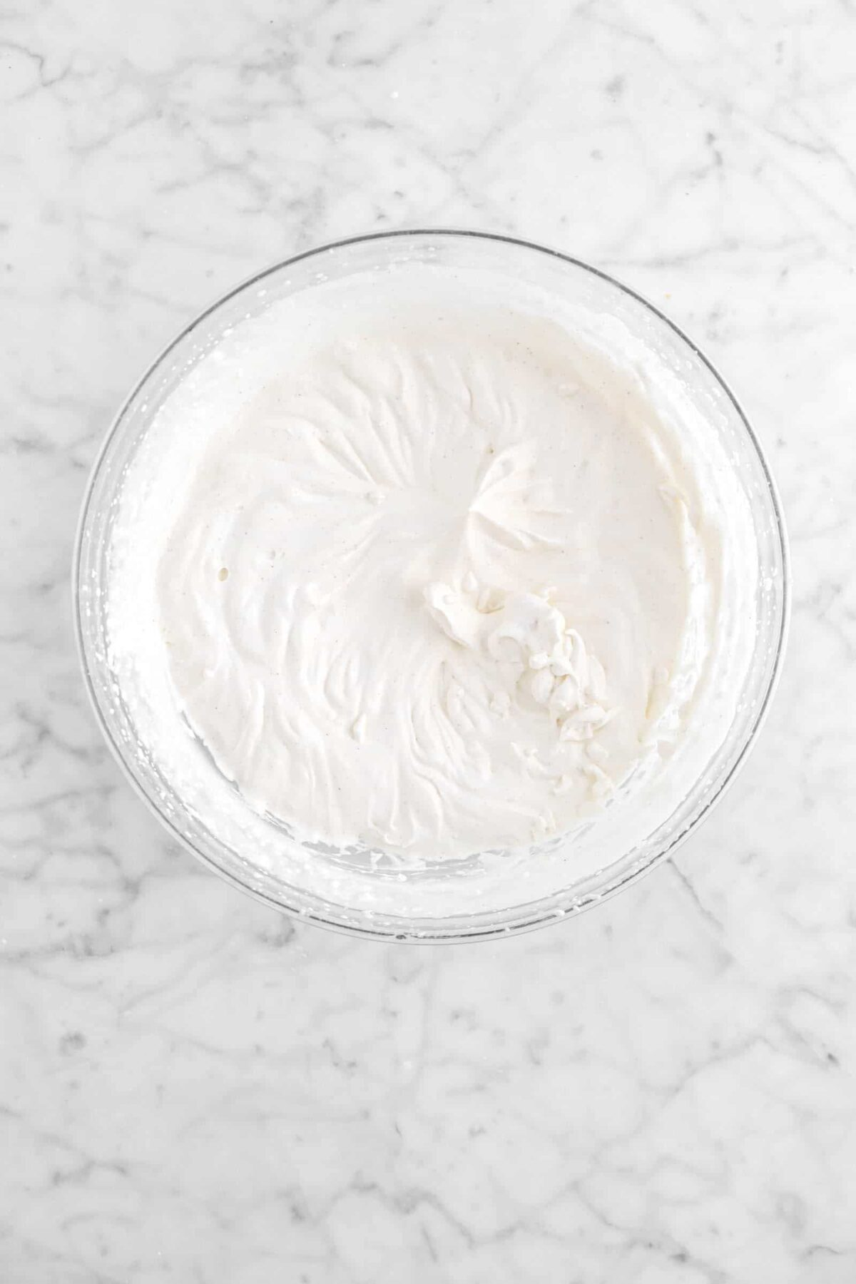 whipped cream in glass bowl