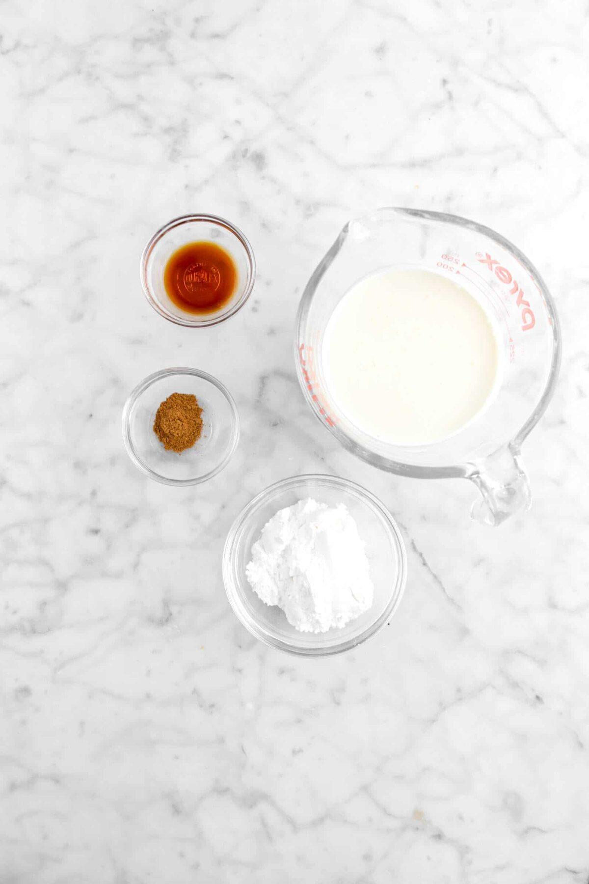 vanilla, pumpkin pie spice, powdered sugar, heavy cream on marble counter